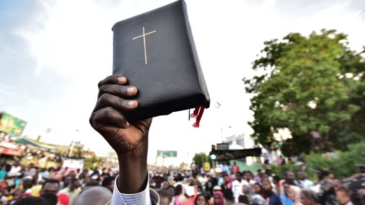 Sudanese Christians during one of the protests that led to the fall of general mar al-Bashir