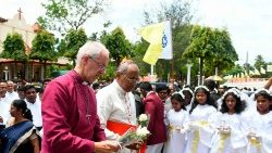 Anglican Archbishop Justin Welby of Canterbury (L) paying tribute to the victims of the Easter Sunday terrorist attack at St. Sebastian's Church in Negombo, Sri Lanka.