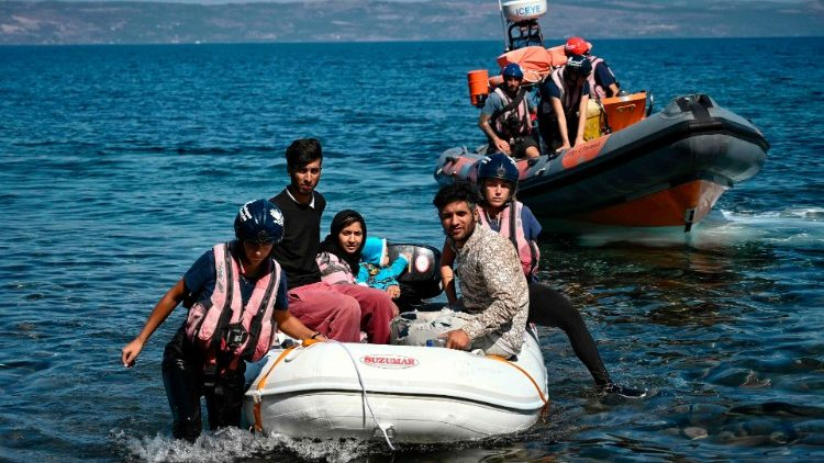 Migrants helped by rescuers in Greece after having crossed the Aegean Sea from Turkey