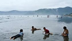 Philippine children at  play  on a beach.