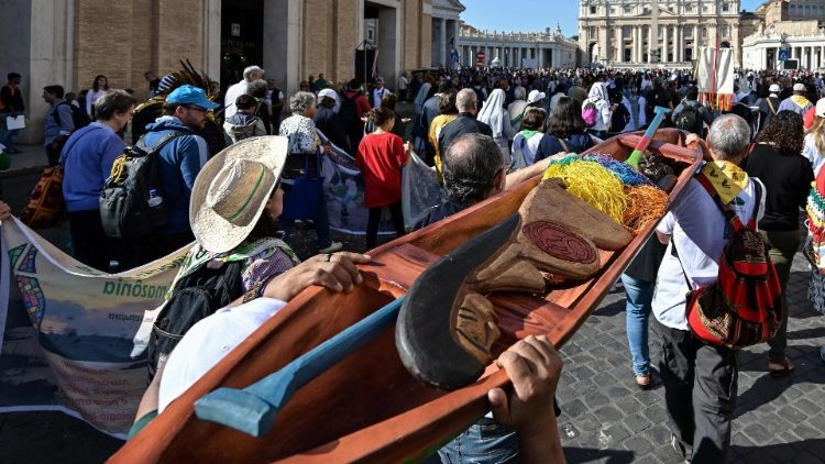 Wooden statue of a young pregnant woman in procession towards St. Peter's Basilica