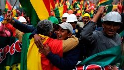 Bolivians take to the streets in La Paz to celebrate the resignation of President Evo Morales