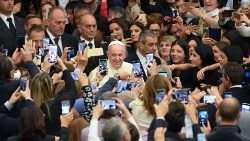 Students and teachers of Rome's LUMSA university take photos of Pope Francis