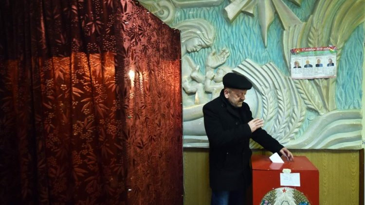 A man casts his ballot at a polling station in Belarus