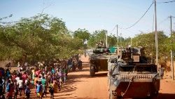 Soldiers patrol a village in northern Burkina Faso