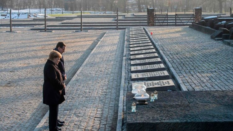 The German Chancellor, Angela Merkel, and Polish Prime Minister Mateusz Morawiecki at Auschwitz