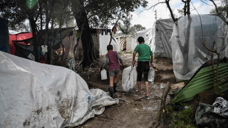 Boys fetching water in a makeshift migrants' camp in the Greek island of Chios.