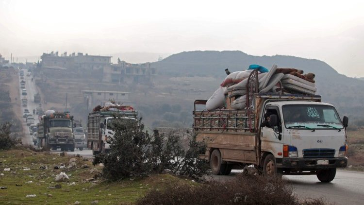 Syrian families fleeing the escalation of government offensive in Idlib province.