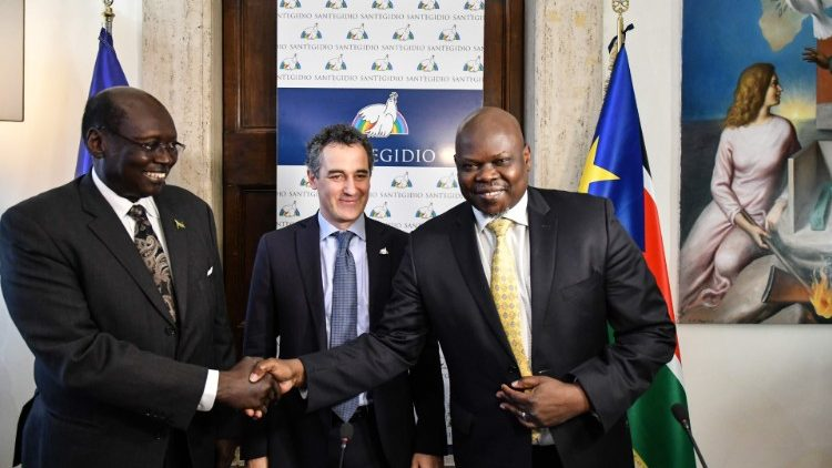 South Sudanese politicians shake hands at St- Egidio headquarters in Rome