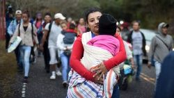 Honduran migrants walk in a caravan to the US