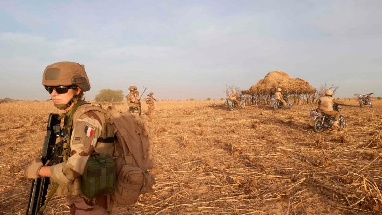 (File photo) French soldiers patrol a rural area in northern Burkina Faso