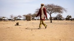 A man walks at a camp sheltering IDPs in Burkina Faso