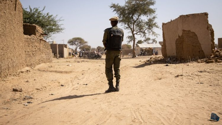 A Burkinabe soldier patrols a northeastern village