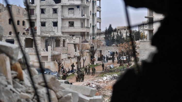 Syrian government forces after taking control of an area in Aleppo province