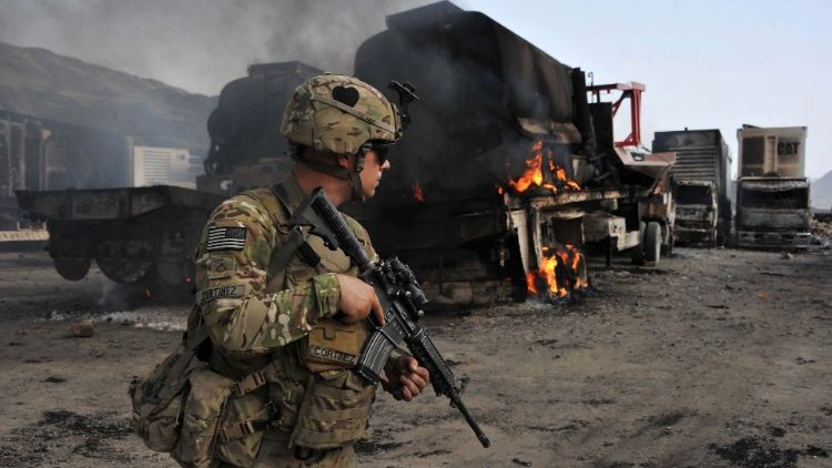 A US soldier investigates the scene of a suicide attack on the Afghan border with Pakistan