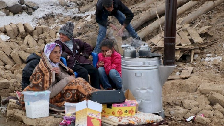 A quake-struck family in Baskale on the border between Iran and Turkey