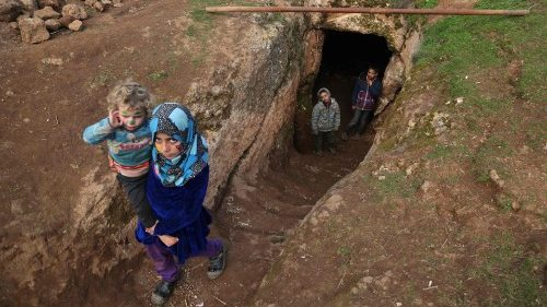 Displaced Syrian children in an underground shelter in Idlib province, Syria.