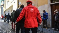 Volunteers from the Order of Malta distribute meals to the homeless in Rome