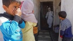 A former school in Syria, inhabited by displaced families, being disinfected.