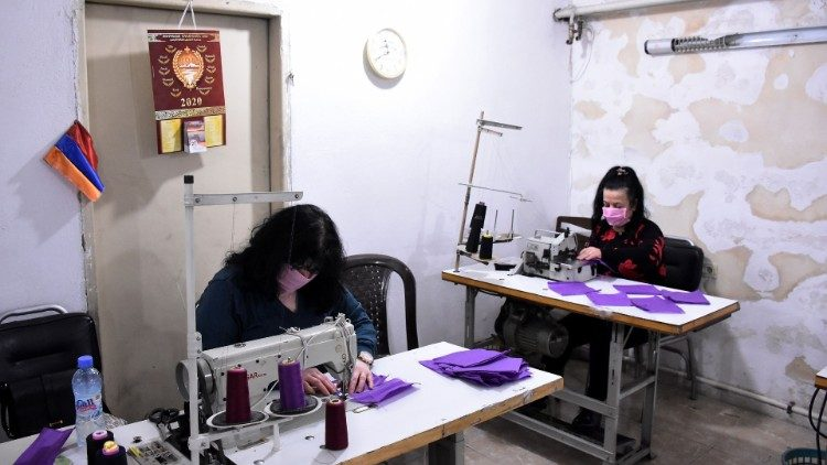Volunteers sew masks for the poor for protection against Covid-19 in the Syrian city of Aleppo