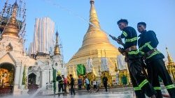 Firefighters disinfecting the Shwedagon Pagoda compound in Yangon.