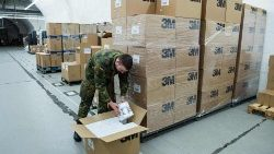 A German Lieutenant unpacks boxes of FFP2 quality masks