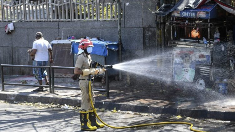A firefighter disinfects a street in New Delhi.