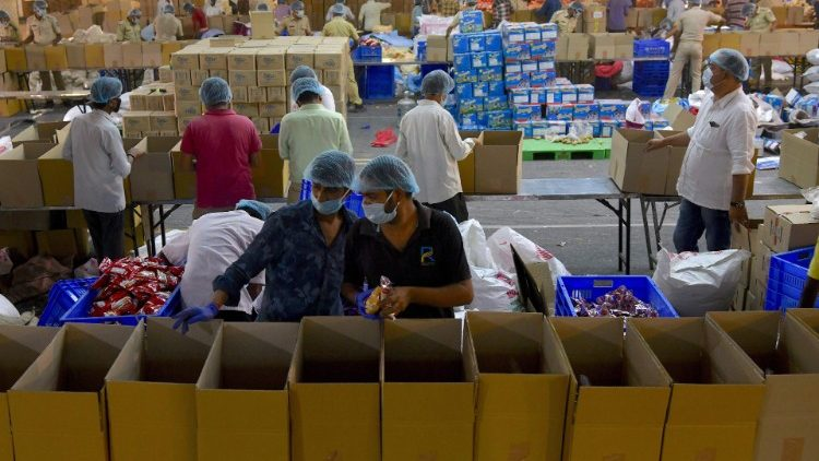 Volunteers sort essentials and groceries for the needy in Bangalore,  during India's lockdown.