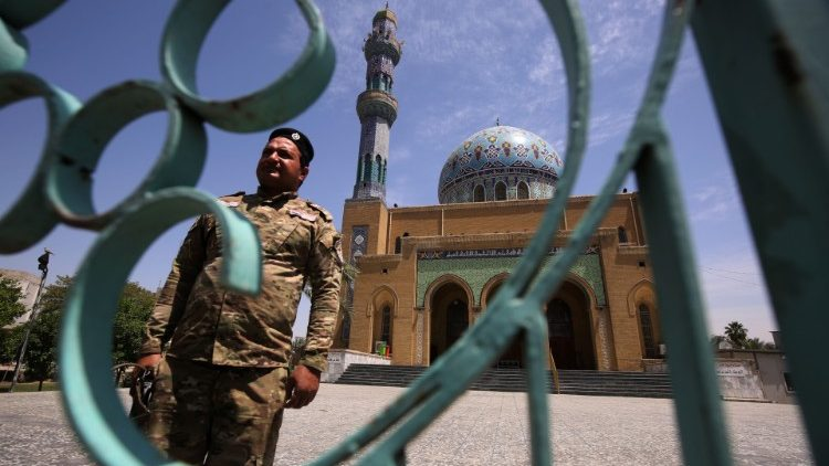 A soldier guards a closed mosque in the Iraqi capital of Baghdad
