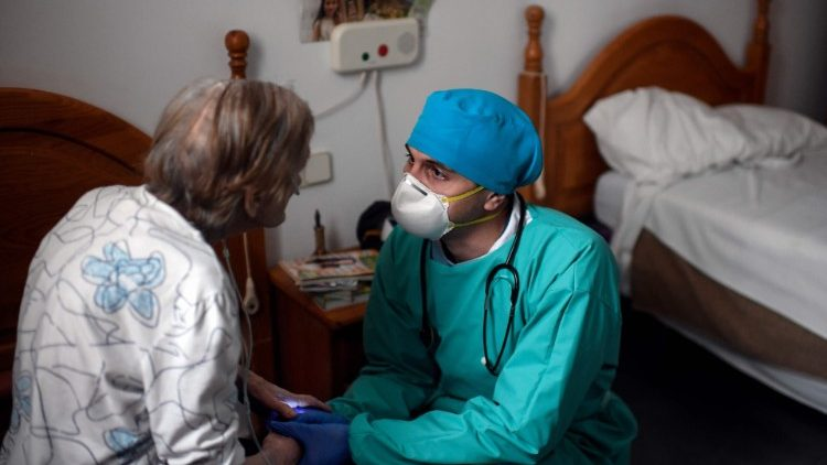 A doctor talking to an elderly Covid-19 patient in Madrid, Spain.