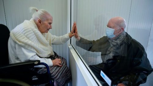 An elderly woman infected with Covid-19 meeting her son at an old age home in Belgium.