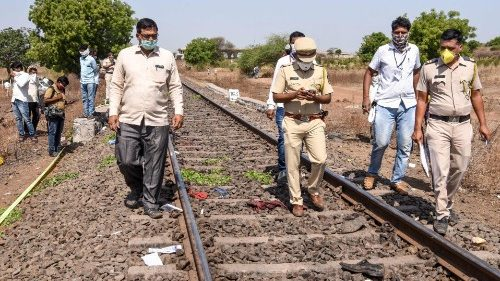 Police inspecting the site where a freight train killed 16 migrant workers in Maharashtra state, India.