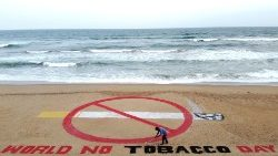 Indian sand artist Sudarshan Patnaik with an artwork on the eve of World No Tobacco Day 2020.