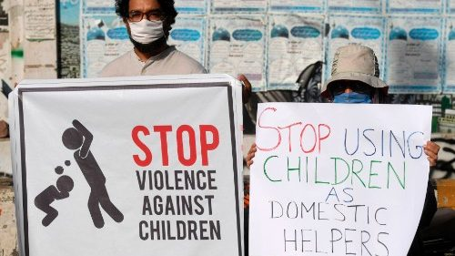 Activists carry placards during a protest in Pakistan
