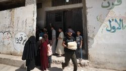 Syrians buy bread in Idlib province, on the third day of anti-regime protests