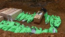A mass grave of the dead bodies of people killed at a jade mine in Kachin state, Myanmar, July 4, 2020.