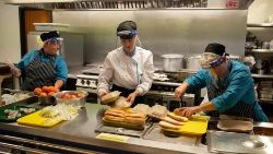 Staff prepare school lunches