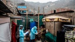 Doctors visit a patient in a poor area near Lima in Peru