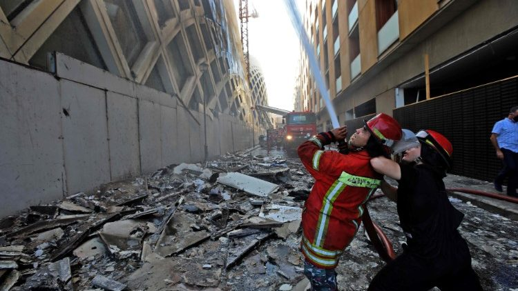 Lebanese firefighters douse the flames of a blaze that engulfed a Beirut building designed by Zaha Hadid
