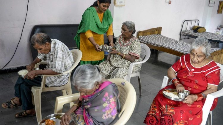 A caregiver tends to elderly people at a home for older people in Secunderabad, India.