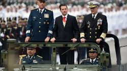 Archive photo of the Mexican President Pena Nieto (C) with Defense Secretary (L) General Salvador Cienfuegos during a parade
