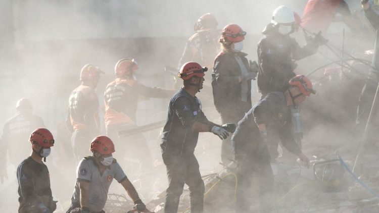 Search and rescue volunteers search the rubble of a collapsed building in Izmir