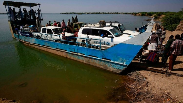 UNICEF transport arrives by ferry to a reception centre in Sudan