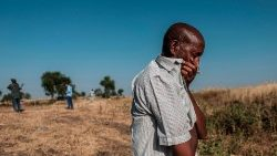 A man cries over a mass grave near Mai Kadra, Ethiopia