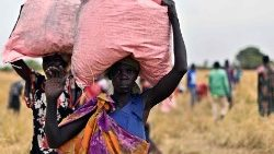 The World Food Programme delivers aid to a village in South Sudan as part of its effort to provide assistance to millions of people impacted by the pandemic and with famines looming