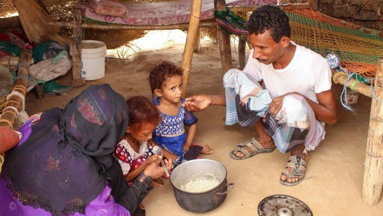 Malnourished children being fed by thier parents in a camp for the displaced in Yemen.