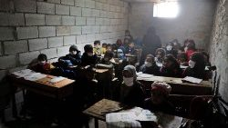 Syrian school children in a makeshift school set up by locals in the village of Ma'arin