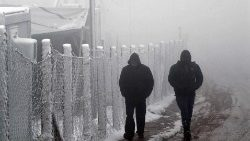 Migrants walk in harsh winter condititions near the Bosnian town of Lipa