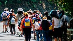 Venezuelan migrants walking along a highway in Columbia