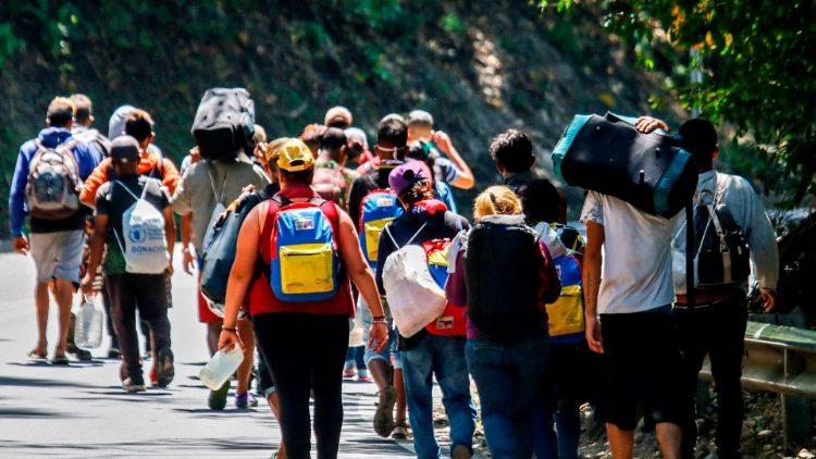 Venezuelan migrants walk along a highway in Cucuta, Colombia